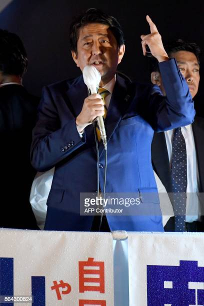 Japan's Prime Minister and ruling Liberal Democratic Party leader Shinzo Abe delivers his speech during his last stumping tour for the October 22...