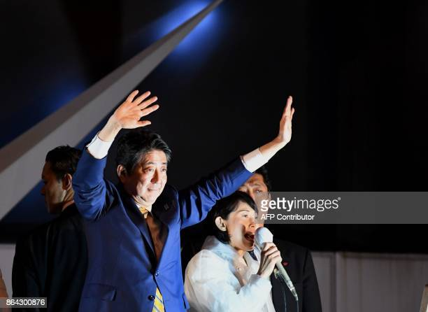 Japan's Prime Minister and ruling Liberal Democratic Party leader Shinzo Abe waves to supporters during his last stumping tour for the October 22...