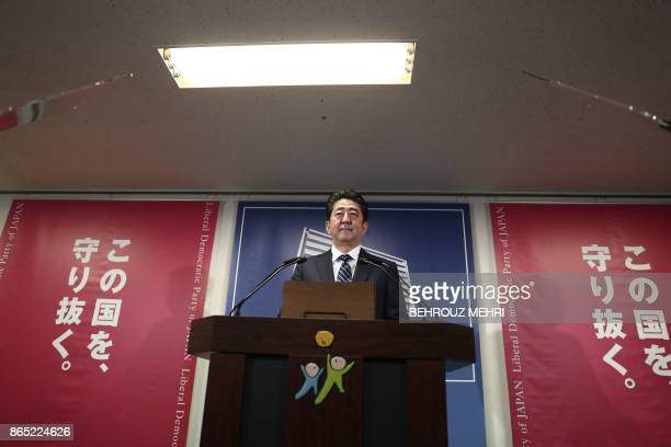 Japan's Prime Minister and ruling Liberal Democratic Party leader Shinzo Abe attends a press conference at the party headquarters in Tokyo on October...