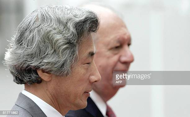 Japan's Prime Minister Junichio Koizumi is accompanied by Chilean President Ricardo Lagos as he arrives at the La Moneda Palace in Santiago 21...