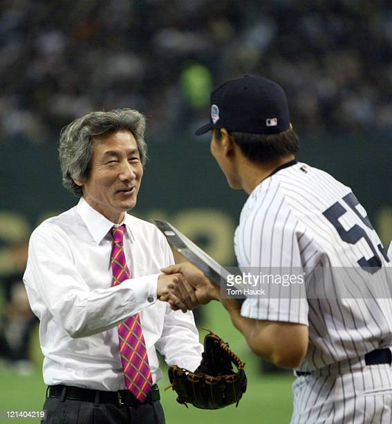 Japan's Prime Minister Junichiro Koizumi is presented with a commemorative home plate by New York Yankee Hideki Matsui MLB Opening Day the New York...
