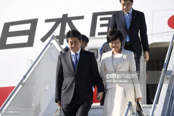 Japan's Prime Minister Shinzo Abe and his wife Akie Abe arrive at the Helsinki International Airport in Vantaa Finland on July 9 2017 / AFP PHOTO /...