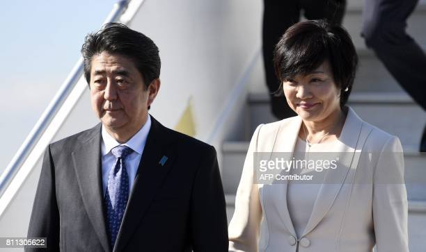 Japan's Prime Minister Shinzo Abe and his wife Akie Abe arrive at the Helsinki International Airport in Vantaa near Helsinki Finland on July 9 2017 /...