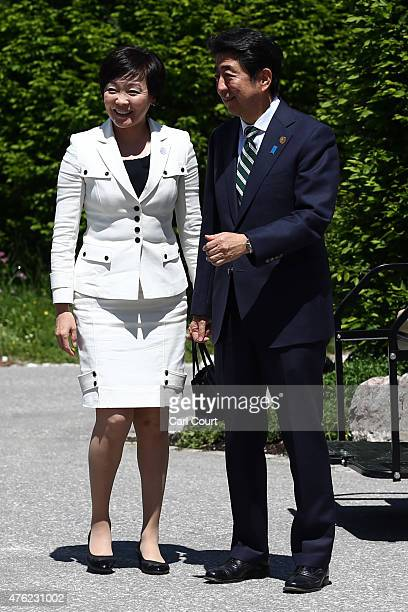 Japan's Prime Minister Shinzo Abe and his wife Akie Abe arrive to be greeted by Germany's Chancellor Angela Merkel upon their arrival at Schloss...