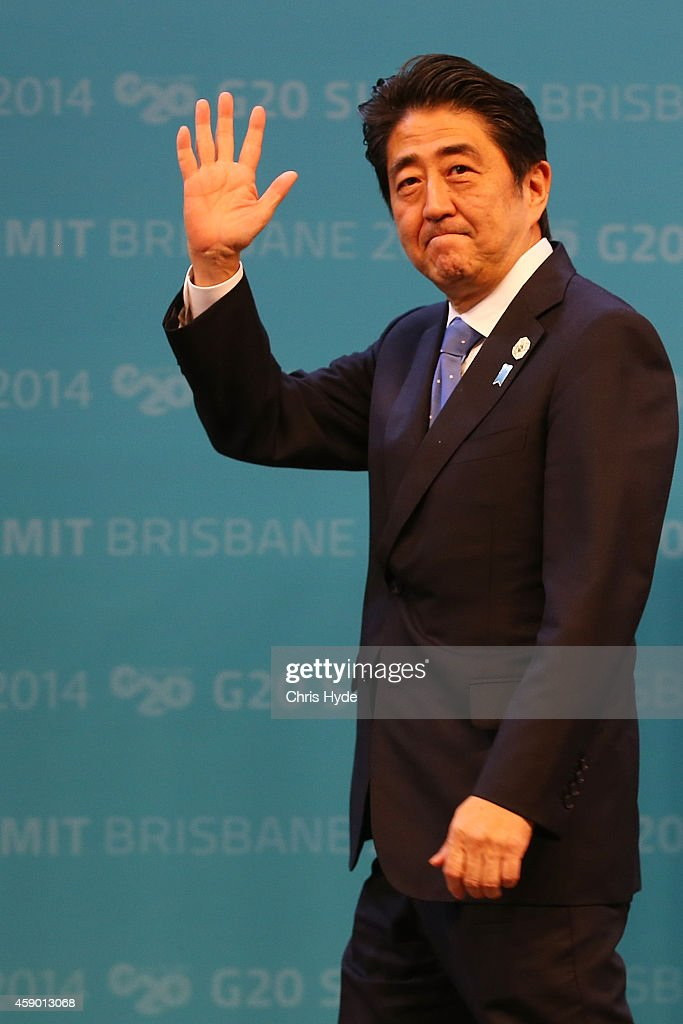 Japan's Prime Minister <a gi-track='captionPersonalityLinkClicked' href=/galleries/search?phrase=Shinzo+Abe&family=editorial&specificpeople=559017 ng-click='$event.stopPropagation()'>Shinzo Abe</a> arrives for the official welcome at the Brisbane Convention and Exhibitions Centre on November 15, 2014 in Brisbane, Australia. World leaders have gathered in Brisbane for the annual G20 Summit and are expected to discuss economic growth, free trade and climate change as well as pressing issues including the situation in Ukraine and the Ebola crisis.