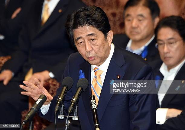 Japan's Prime Minister Shinzo Abe gestures as he answers questions from a parliament member at a committee of the lower house to discuss...