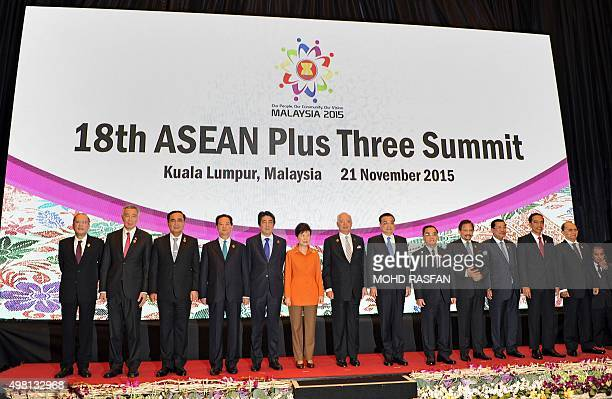 Japan's Prime Minister Shinzo Abe South Korean President Park GeunHye and Chinese Premier Li Keqiang pose for a group photo with ASEAN leaders during...