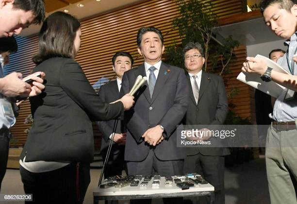 Japan's Prime Minister Shinzo Abe speaks to the press at his office in Tokyo on May 21 regarding a ballistic missile that North Korea launched on the...