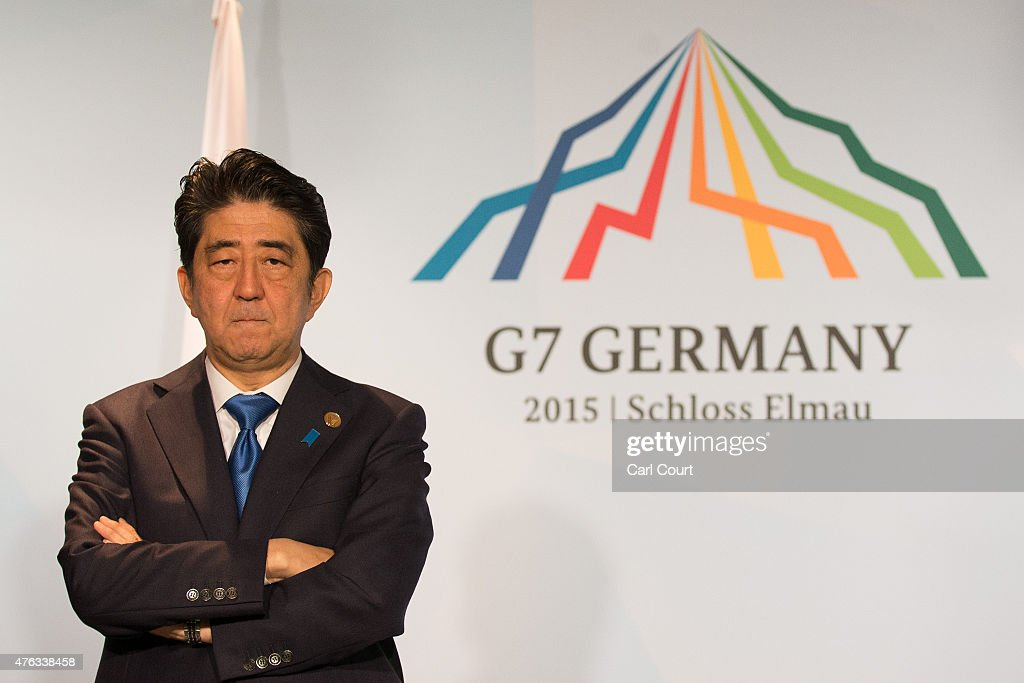 Japan's Prime Minister Shinzo Abe waits for the arrival of Britain's Prime Minister David Cameron as they conduct a bilateral meeting at the summit of G7 nations at Schloss Elmau on June 8, 2015 near Garmisch-Partenkirchen, Germany. In the course of the two-day summit G7 leaders are scheduled to discuss global economic and security issues, as well as pressing global health-related issues, including antibiotics-resistant bacteria and Ebola. Several thousand protesters have announced they will seek to march towards Schloss Elmau and at least 17,000 police are on hand to provide security.