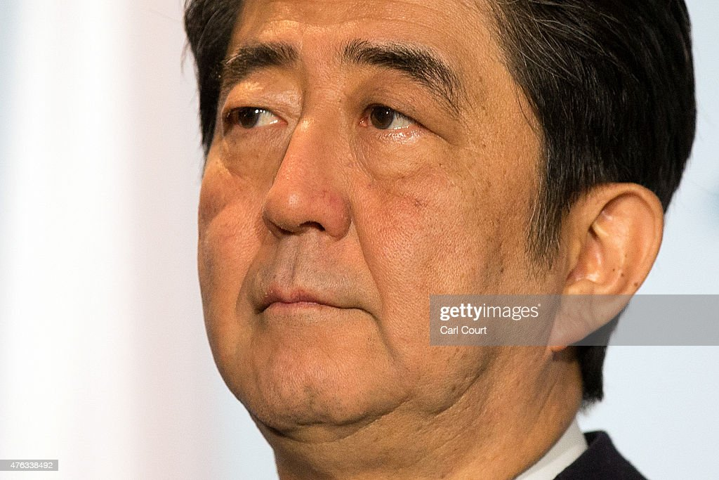 Japan's Prime Minister <a gi-track='captionPersonalityLinkClicked' href=/galleries/search?phrase=Shinzo+Abe&family=editorial&specificpeople=559017 ng-click='$event.stopPropagation()'>Shinzo Abe</a> waits for the arrival of Britain's Prime Minister David Cameron as they conduct a bilateral meeting at the summit of G7 nations at Schloss Elmau on June 8, 2015 near Garmisch-Partenkirchen, Germany. In the course of the two-day summit G7 leaders are scheduled to discuss global economic and security issues, as well as pressing global health-related issues, including antibiotics-resistant bacteria and Ebola. Several thousand protesters have announced they will seek to march towards Schloss Elmau and at least 17,000 police are on hand to provide security.