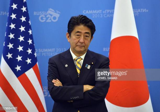 Japans Prime Minister Shinzo Abe waits for US President to arrive for a bilateral meeting on the sideline of the G20 summit in Saint Petersburg on...