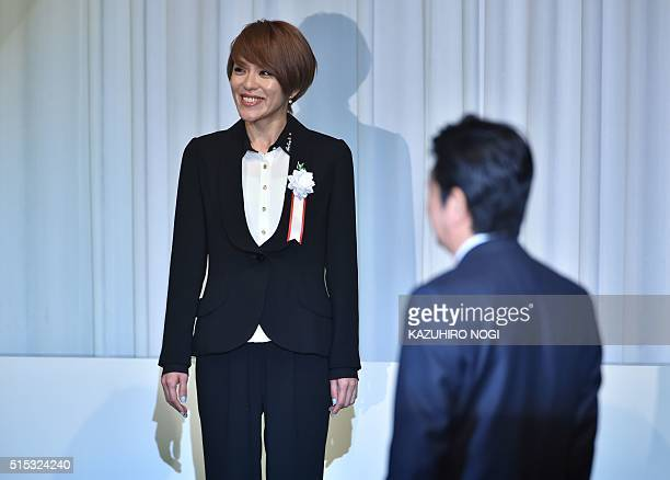 Japan's Prime Minister Shinzo Abe who heads the ruling Liberal Democratic Party welcomes LDP candidate for the House of Councillors election Eriko...