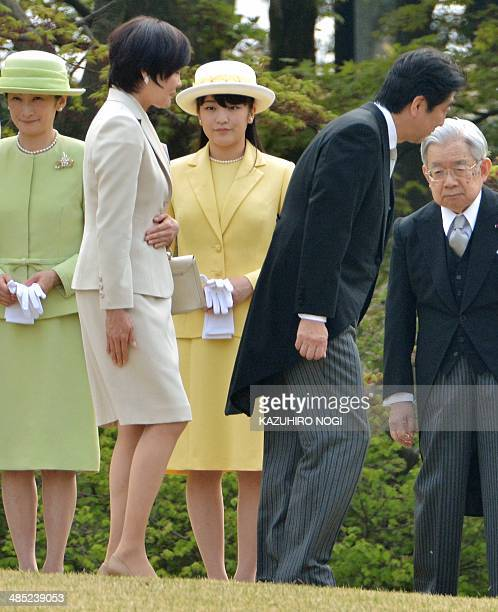 Japan's Prime Minister Shizo Abe and his wife Akie walk past Princess Kiko Princess Mako and Prince Hitachi during the annual spring garden party at...