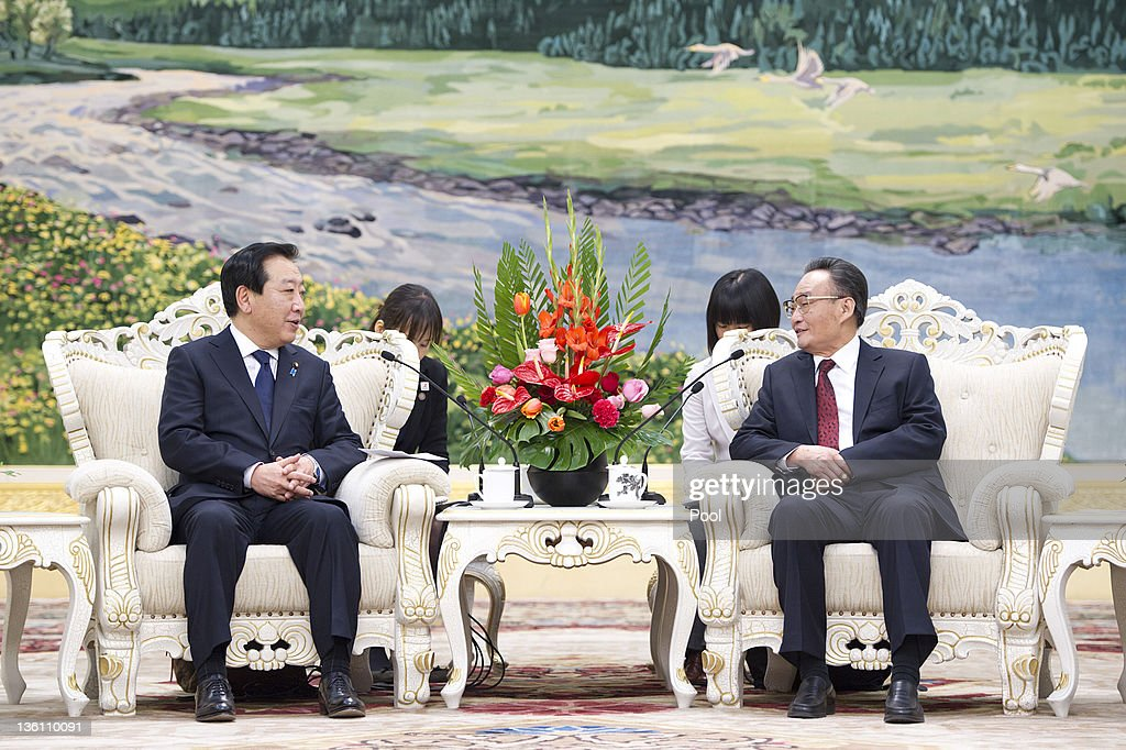Japan's Prime Minister Yoshihiko Noda attends a meeting with China's National People's Congress Chairman Wu Bangguo at the Great Hall of the People...