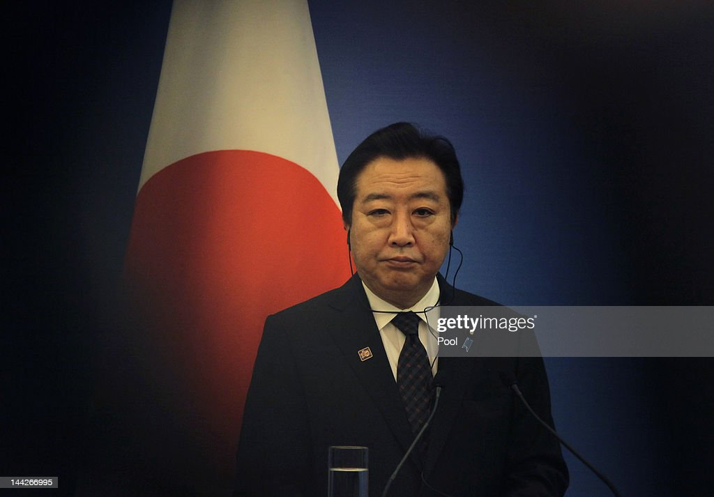 Japan's Prime Minister Yoshihiko Noda stands in front of a Japanese national flag as he attends a joint news conference of the fifth trilateral summit among China, South Korea and Japan at the Great Hall of the People on May 13, 2012 in Beijing, China. The three nations are meeting for talks focused on maintaining strong relations, the global economy and disaster relief. The trilateral summits began in 2008.
