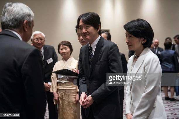 Japan's Prince Akishino and her wife Princess Kiko meet with citizens of Japanese descendants in Santiago September 262017 as part of their...