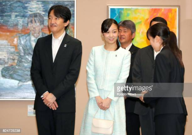 Japan's Prince Akishino and his daughter Princess Kako view artwork displayed at the allJapan senior high school cultural festival in Sendai...