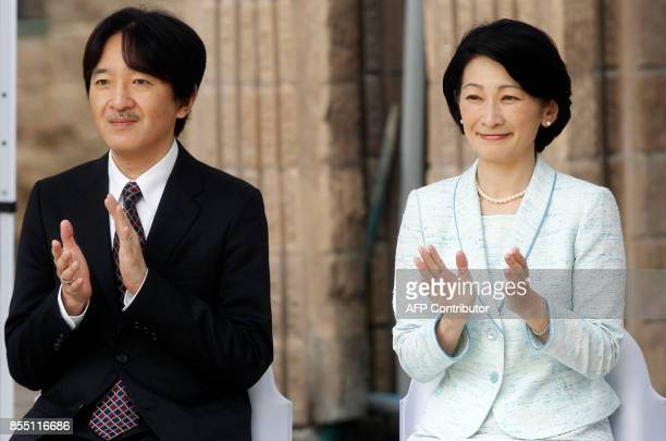 Japan's Prince Akishino and his wife Princess Kiko applaud during a visit to a Japanese school in Santiago on September 28 2017 / AFP PHOTO / CLAUDIO...