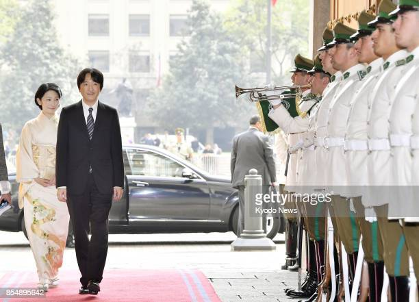 Japan's Prince Akishino and his wife Princess Kiko arrive at Moneda Palace in Santiago on Sept 27 to pay a courtesy call on Chilean President...