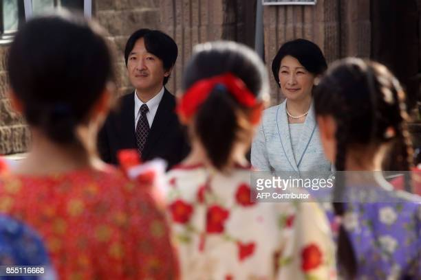 Japan's Prince Akishino and his wife Princess Kiko attend a performance during a visit to a Japanese school in Santiago on September 28 2017 / AFP...