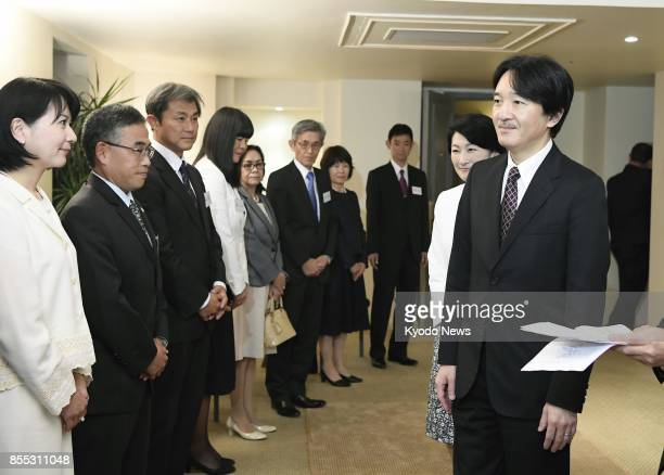 Japan's Prince Akishino and his wife Princess Kiko meet with Japan International Cooperation Agency staff members in Santiago on Sept 28 2017 The...