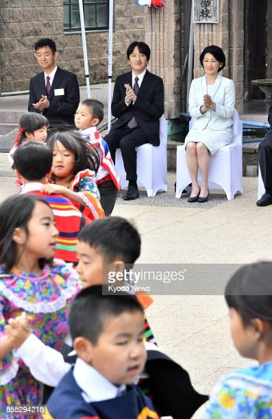 Japan's Prince Akishino and his wife Princess Kiko visit a school for Japanese children in Santiago on Sept 28 2017 The couple are on an official...