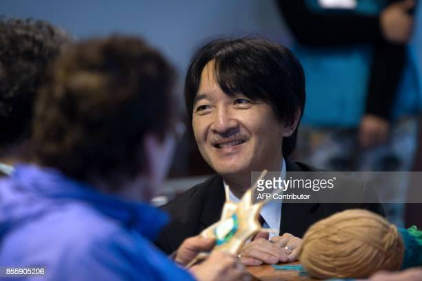 Japan's Prince Akishino and his wife Princess Kiko visit the adult rehabilitation centre Cesfam in Puerto Montt about 1000 km south of Santiago on...