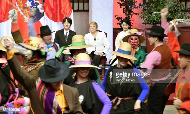 Japan's Prince Akishino and his wife Princess Kiko watch traditional Chilean dance together with Chilean President Michelle Bachelet in Santiago on...