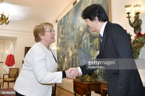 Japan's Prince Akishino shakes hands with Chilean President Michelle Bachelet in Santiago on Sept 27 2017 The prince together with his wife Princess...