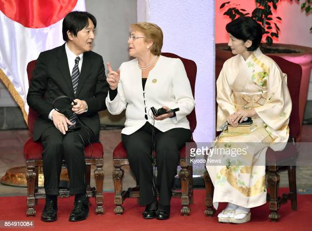 Japan's Prince Akishino talks with Chilean President Michelle Bachelet during a ceremony commemorating the 120th anniversary of diplomatic ties...