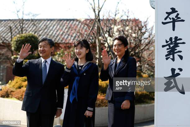 Japan's Princess Aiko accompanied by her parents Crown Prince Naruhito and Crown Princess Masako waves to wellwishers as they attend her graduation...