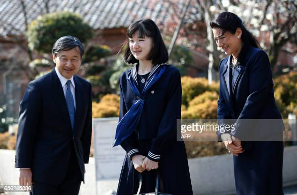 Japan's Princess Aiko accompanied by her parents Crown Prince Naruhito and Crown Princess Masako smiles to wellwishers as they attend her graduation...