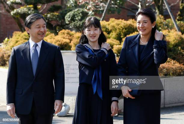 Japan's Princess Aiko accompanied by her parents Crown Prince Naruhito and Crown Princess Masako attends her graduation ceremony at the Gakushuin...