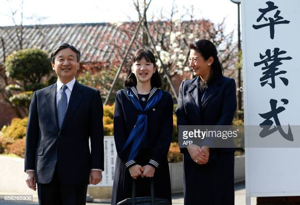 Japan's Princess Aiko accompanied by her parents Crown Prince Naruhito and Crown Princess Masako poses for photos as they attend her graduation...