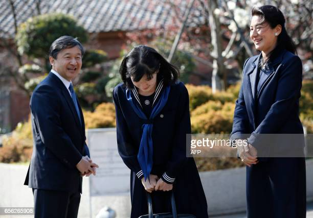 Japan's Princess Aiko accompanied by her parents Crown Prince Naruhito and Crown Princess Masako bows to wellwishers as they attend her graduation...