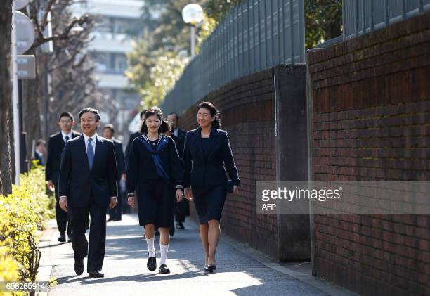 Japan's Princess Aiko accompanied by her parents Crown Prince Naruhito and Crown Princess Masako arrives at her graduation ceremony at the Gakushuin...