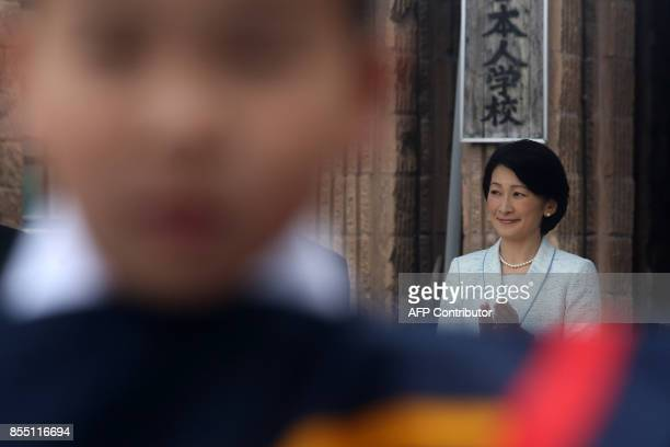 Japan's Princess Kiko enjoys a performance during a visit to a Japanese school in Santiago on September 28 2017 / AFP PHOTO / CLAUDIO REYES