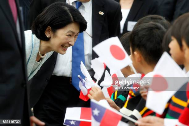 Japan's Princess Kiko greets children during a visit to a Japanese school in Santiago on September 28 2017 / AFP PHOTO / CLAUDIO REYES