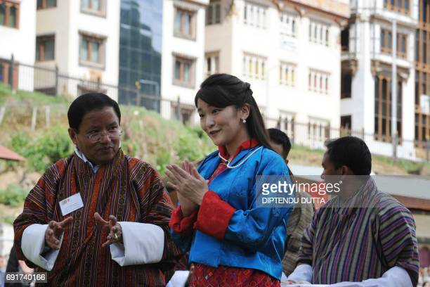 Japan's Princess Mako applauds participants in an archery match at the Changlingmethang National Archery ground in Thimphu on June 3 2017 Japan's...