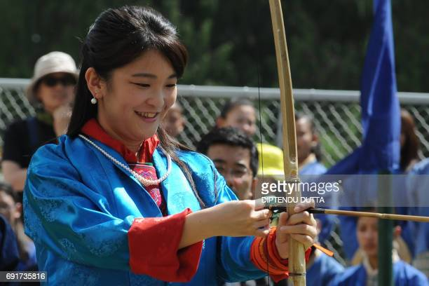 Japan's Princess Mako prepares to shoot an arrow at the Changlingmethang National Archery ground in Thimphu on June 3 2017 Japan's Princess Mako the...