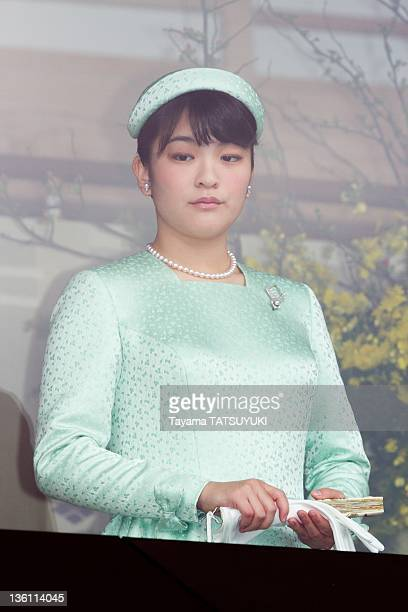 Japan's Princess Mako stands on a balcony at the Imperial Palace on Emperor Akihito's 78th birthday on December 23 2011 in Tokyo Japan
