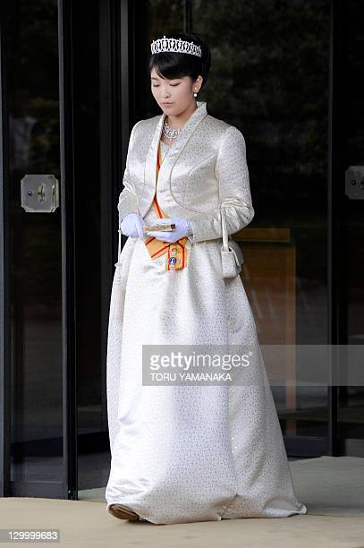 Japan's Princess Mako the first daughter of Prince Akishino and Princess Kiko in full dress leaves the Imperial Palace in Tokyo after meeting with...