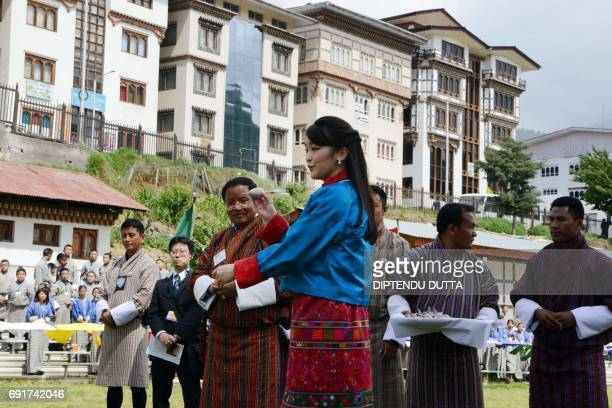 Japan's Princess Mako throws a traditional dart called a khuru at the Changlingmethang National Archery ground in Thimphu on June 3 2017 Japan's...