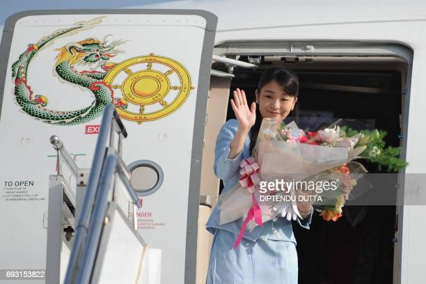 Japan's Princess Mako waves prior to her departure from Paro Airport in Bhutan on June 7 2017 Japan's Princess Mako the oldest of Emperor Akihito's...