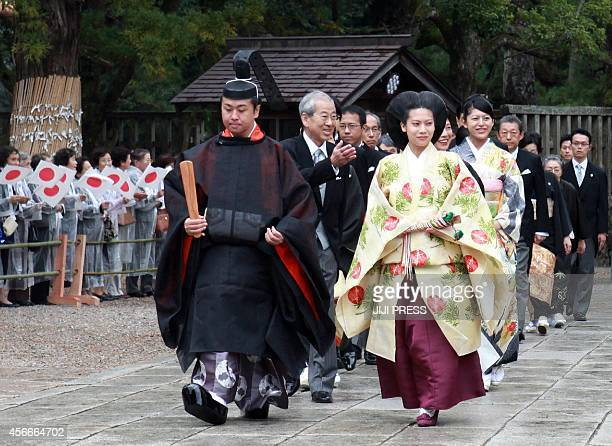 Japans Princess Noriko second daughter of the late Prince Takamado dressed in an ancient Japanese formal court and Kunimaro Senge the eldest son of...