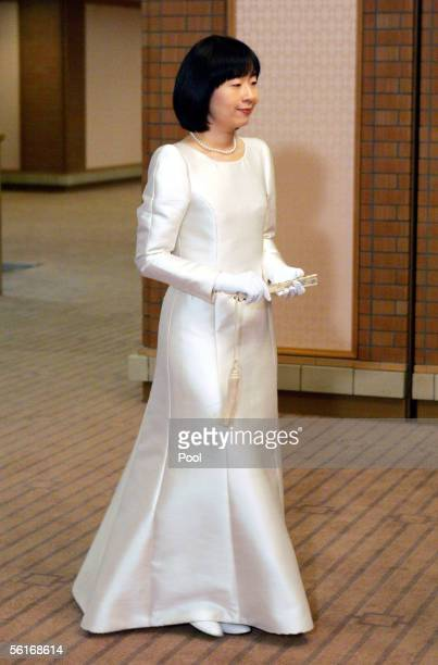 Japan's Princess Sayako arrives with her fiance Yoshiyuki Kuroda to a room for their wedding ceremony at a Tokyo hotel November 15 2005 in Tokyo...