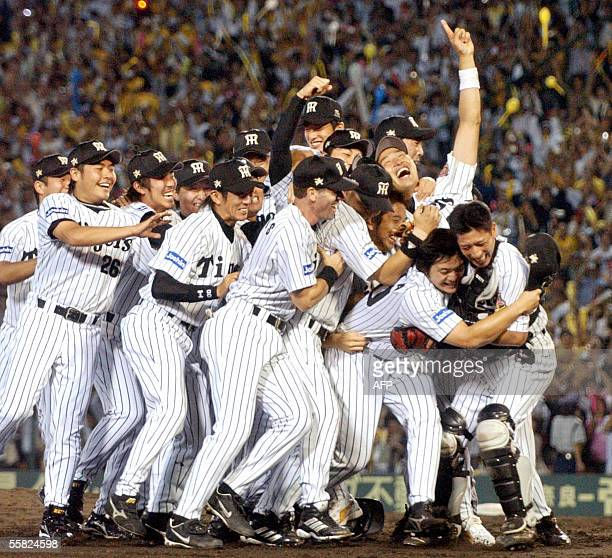 Japan's professional baseball team Hanshin Tigers players celebrate their victory of the Central League championship each other at the Koshien...