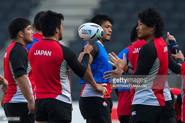 Japan's prop Keita Inagaki gestures during the captain's run team training session in Milton Keynes north of London on October 2 2015 on the eve of...