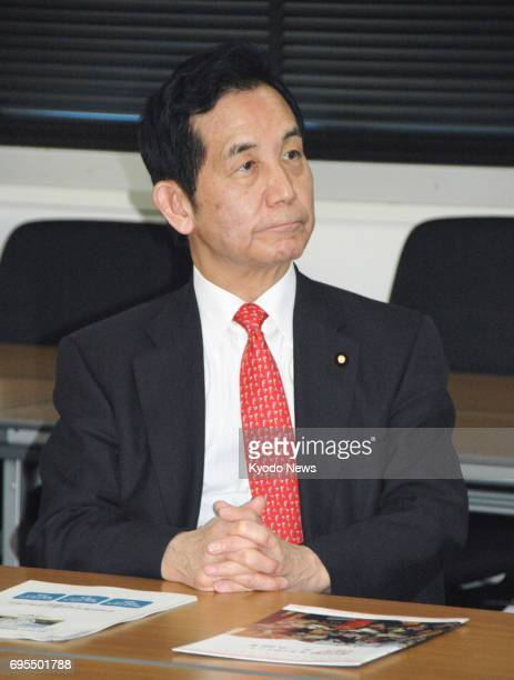 Japan's regional revitalization minister Kozo Yamamoto is pictured during a visit to Kochi University in Nankoku on April 23 2017 The main opposition...