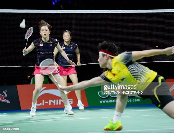 Japan's Reika Kakiiwa and Miyuki Maeda compete against China's Wang Xiaoli and Yu Yang during the women's double semi final match at the 2014 BWF...